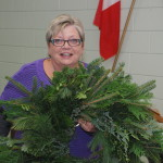 Jan Torrell displaying a finished wreath
